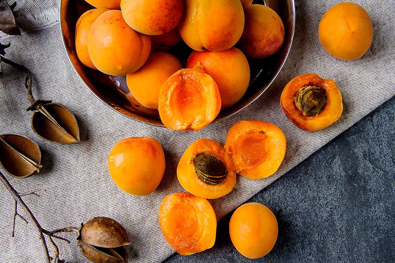 Fresh apricots in a bowl on a table