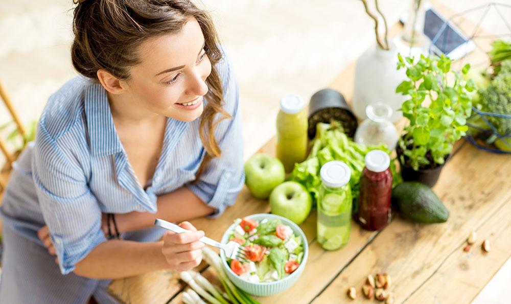 Female happy eating healthy food