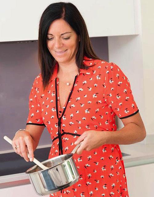 Dr Sarah Schenker cooking in her kitchen