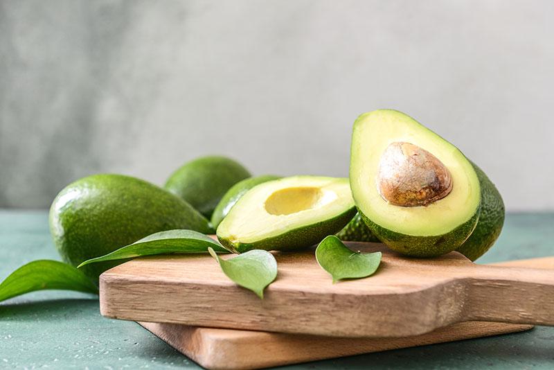 Fresh avocados on a chopping board
