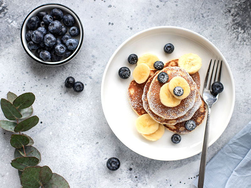 Blueberry pancakes with banana slices